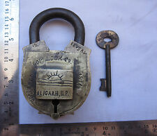 An old solid brass padlock lock trick or puzzle decorative shape hidden key hole