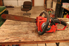 Vintage Homelite EZ start chainsaw for parts or repair.