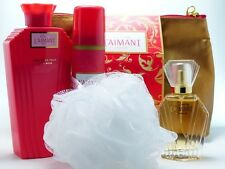 Coty L`Aimant Set  PdT 30 ml + Puder 100 g + Deospray 75 ml + Bag + Schwamm
