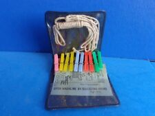 MINIATURE DOLL/ DOLLHOUSE CLOTHES PINS AND CLOTHESLINE- IN ADVERTISING FOLDER