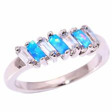 STUNNING BLUE FIRE OPAL/TOPAZ 7 STONE RING  UK SIZE   M