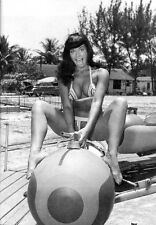 Bettie Page Riding on Kiddie Amusement Ride 5 x 7 Photograph