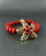 Red Stone Bead Gold Tone Starfish Stretch Bracelet