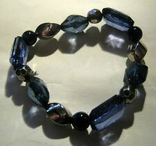 Pretty elasticated plastic beaded bracelet in blue silver and black