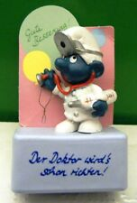 2.0037 GERMAN LANGUAGE DOCTOR SMURF ON RECTANGULAR STAND – VERY GENT USED