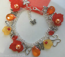 Hand made tibetan silver butterfly loaded charm bracelet red orange 7.5in gift