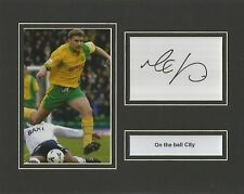 A 10 x 8 inch mounted display personally signed by Matt Jackson of Norwich City