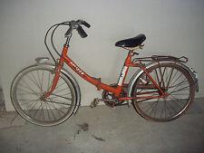 mini vélo pliant vintage couleur orange..marque: FLÈCHE D'OR.