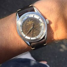 Vintage Tropical Universal Genève Polerouter Date Watch