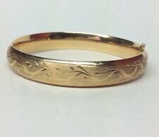 14K YELLOW GOLD BANGLE BRACELET GORGEOUSLY DESIGNED
