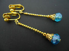 A PAIR OF  LONG SKY BLUE CRYSTAL TEARDROP  GOLD PLATED CLIP ON EARRINGS.