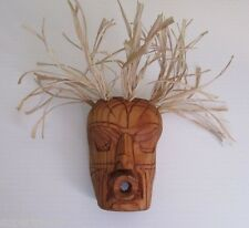 SLEEPING WILD WOMAN Miniature salish dance mask carved in red cedar.