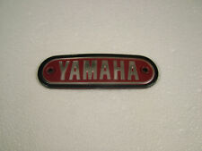 YAMAHA  AT1, JT1, CT1 '69 RED  REPRODUCTION PLASTIC TANK BADGE.