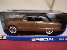 Maisto 1950 Ford Convertible w/ rear continental kit    1/18th scale new in box
