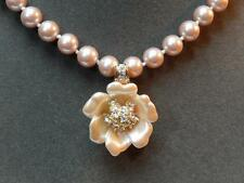 Nolan Miller Pink-Mauve Pearl Necklace with Rhinestone Accented Flower Enhancer
