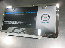Mazda CX-3 2016 New OEM polished stainless steel license plate frame 0000-83-S35