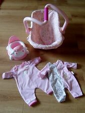 BABY ANNABELL DOLL BUNDLE (CAR SEAT, INTERACTIVE TOILET AND ROMPERS X 2)