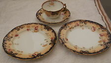 CUP, SAUCER AND TWO SIDE PLATES  WITH A FLORAL PATTERN  NO MAKERS MARK