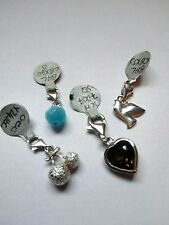 Set of 4 Assorted Sterling Silver Clip-on Charms.  Brand new in box.