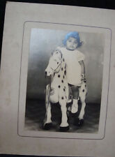 Old vintage Black & White photos of Baby sitting on Pedal Horse toy  from India