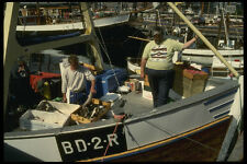 219038 A Fishing Boat Ties Up With Another Fresh Catch A4 Photo Print