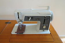 """Singer 611 G sewing machine and """"retro"""" sewing cabinet."""