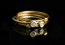Four handmade delicate 14k yellow gold  rings 2 with diamonds 2 without diamond