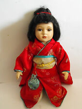 Porcelain doll kneeling Japanese girl