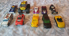 Hot Wheels Lot of 10 Vehicles Including 1974 Bomb Squad, Wolverine Big Foot,etc.