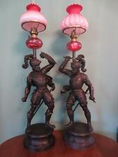 PAIR ANTIQUE(C1890)OIL LAMPS AS DUELING KNIGHTS -CRANBERRY GLASS FONTS & SHADES