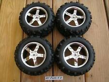 NEW TRAXXAS T-MAXX 3.3 4907 COMPLETE SET OF 4 TIRES AND WHEELS 14mm 2.5 .15 4910