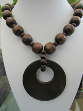 "A CHUNKY DARK-BROWN WOODEN BEAD STRETCH NECKLACE. 20"" + EARRINGS & BRACELET.   1"