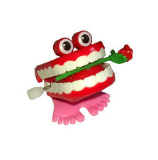 Wind Up Hopping Chattering Teeth With Rose Suprise Your Pets
