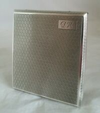 A sterling silver cigarette /card case. Birmingham 1928.By F H Adams & Co.