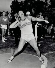 1964 Wire Photo athlete Dallas Long breaks shot put record at West Coast Relays