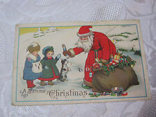 CHRISTMAS  ANTIQUE  SANTA  WITH BAG OF TOYS POSTCARD    T*