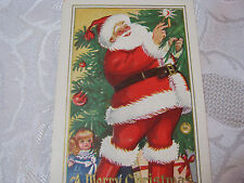 SANTA LIGHTING CHRISTMAS TREE  ANTIQUE  EMBOSSED POSTCARD    T*