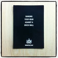 BANKSY!  BANGING YOUR HEAD AGAINST A BRICK WALL! NEW! VERY RARE FIRST BOOK!