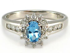 10k White Gold Oval Blue Topaz and .25 ctw Diamond Halo Ring .77 ctw
