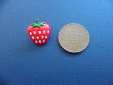Buttons, mini strawberries