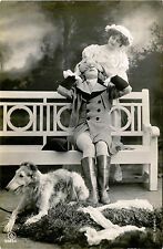DRESSED UP COUPLE WITH DOG & VINTAGE BOSSANO REAL PHOTO POSTCARD