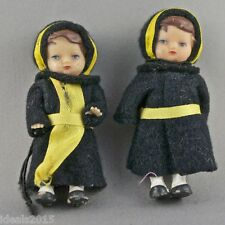 Germany 2 Tiny Rubber Dolls in Black Felt Hooded & Yellow Ribbons Outfits -D112