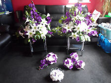 Purple ivory bridal wedding package flowers bouquet centrepieces orchids roses