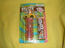 NEW M&M Toy & Pogo dispenser  Spring n Sports team  #36 racing car