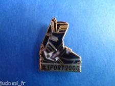 Pin's pin SPORT 2000 CHAUSSURE DE SKI (ref L23)