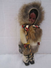 "Vintage native american plastic doll with fur & leather. 7-1/2"" tall."
