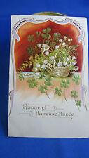 cpa illustrateur fantaisie gaufree panier de fleurs trefle et muguet