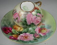 Beautiful Hand Painted cup and saucer With Roses