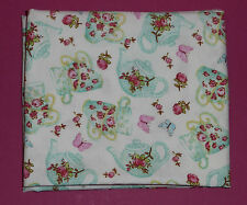 Fabric fat quarter with flower decorated teapots and cups in blue on sky