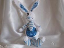 Doudou lapin blanc et bleu, Tape à l'oeil